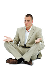 Young employee meditating during lunch time