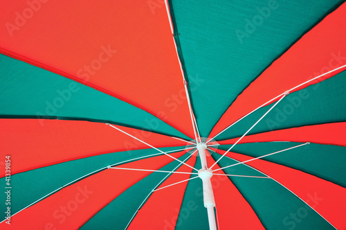 Under red and green umbrella