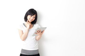 attractive asian woman using tablet computer