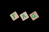 Green letters on old wooden blocks (FAQ)