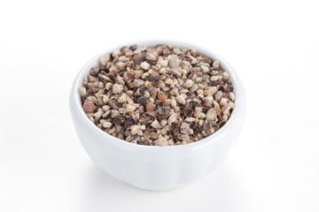 Crushed Black pepper (Piper nigrum) in a white bowl on white bac