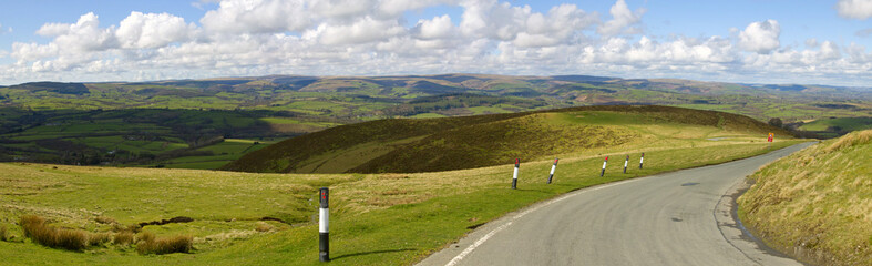 Panoramic view narrow road Welsh hills.