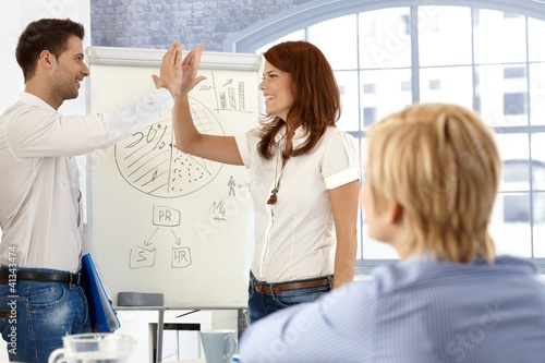 Businesspeople clapping high five