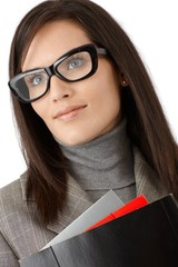 Smiling businesswoman in stylish glasses