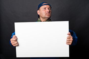 Striker with placard
