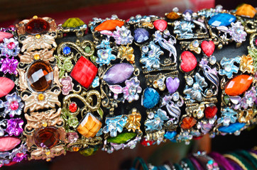 Row of colorful bracelets on jewelry market in Jerusalem