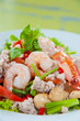 Thai dressed spicy salad with prawn, pork, green herbs and nuts