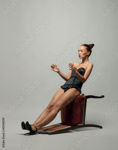 Fashion shoot of a young woman posing in a sexy dress
