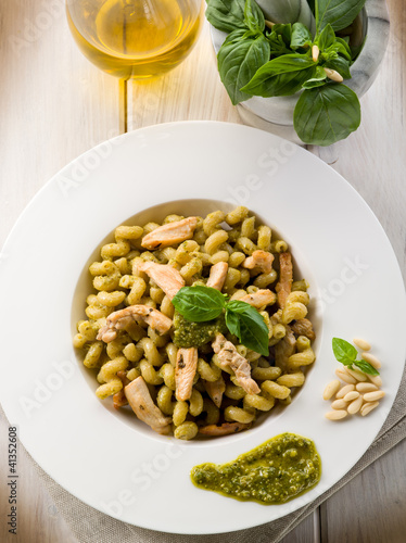 pasta with pesto sauce and chicken breast, healthy food