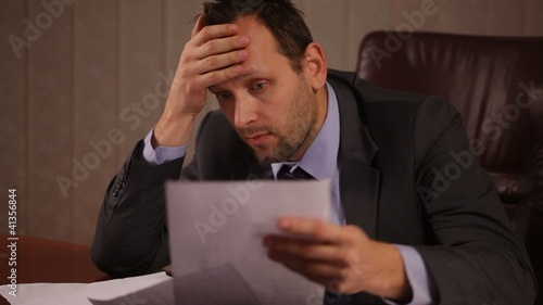 Frustrated businessman in office