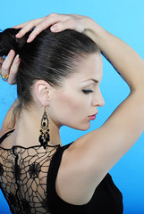 Beautiful girl brunette sits back with withdrewed hair