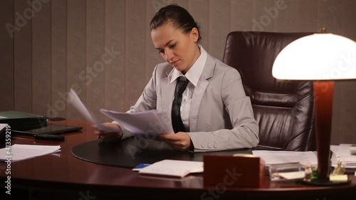 Female boss viewing documents
