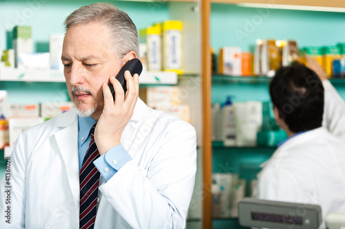 Pharmacist at phone