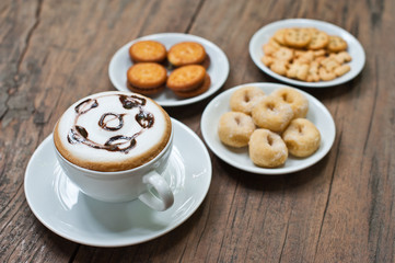 coffee cup with snack on wood table