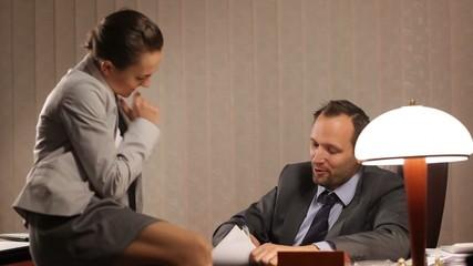 Secretary flirting with boss