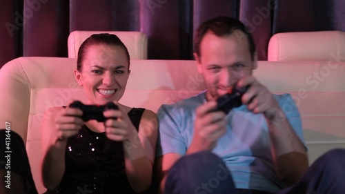 Young couple play video games