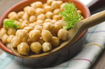 Spoon of chickpeas with fennel leaves