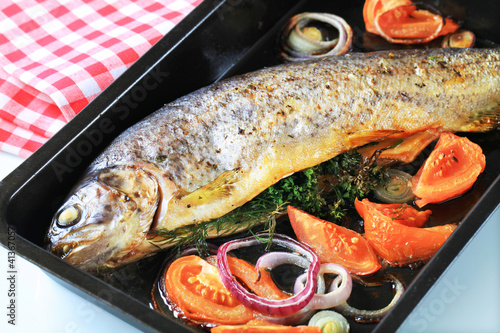 Herb-stuffed trout with tomatoes