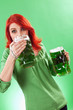 Redhead enjoying green beer