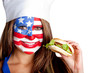 American woman eating hamburger