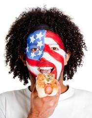 American man eating hotdog