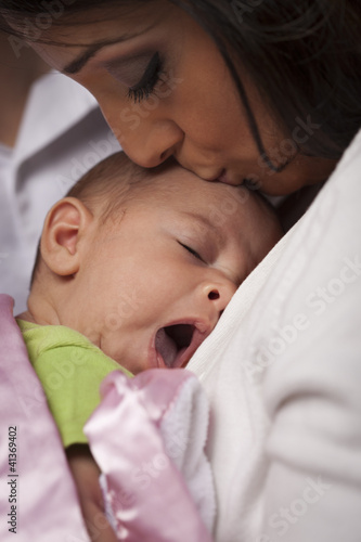 Attractive Ethnic Woman with Her Yawning Newborn Baby