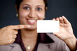 Smiling business woman showing the card