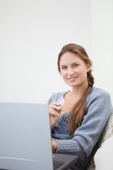 Woman sitting while using her tablet computer