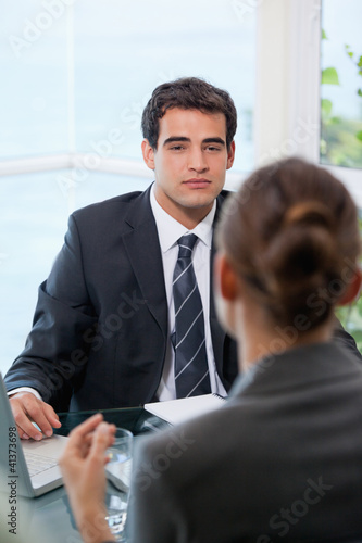 Businessman looking at his client