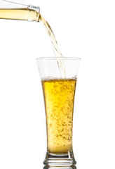Glass of beer being poured from a bottle