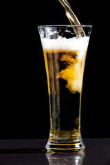 Glass being filled with beer