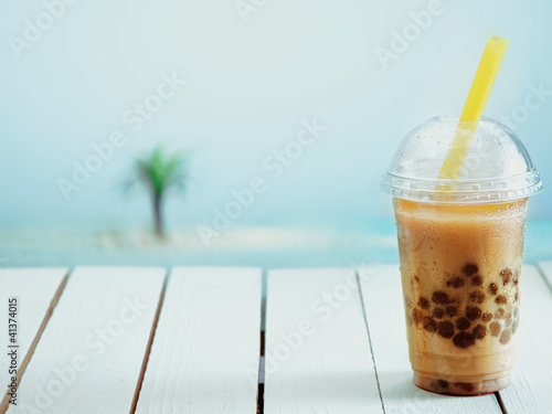 Iced drink in a covered cup