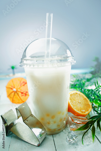 Milky bubble tea with fruit and boba balls