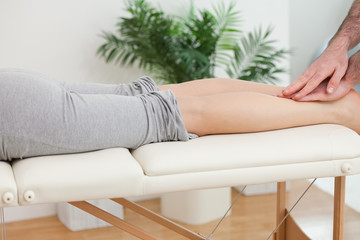Physiotherapist massaging the legs of a woman
