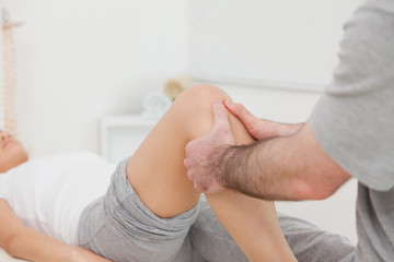 Man massaging the leg of a woman