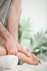 Close up of hands massaging a foot