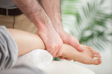 Close-up of a foot being massaged by a doctor