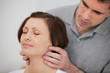 Physiotherapist massaging the neck of a patient