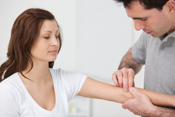 Doctor examining the arm of a patient