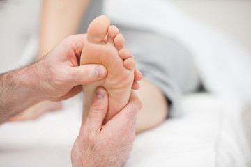 Patient receiving a foot massage