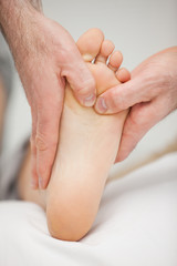 Chiropodist massaging the foot of a patient
