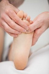 Foot being touched by a chiropodist