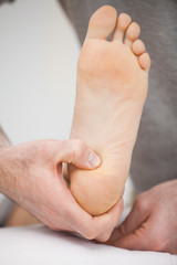 Foot being raised by a chiropodist