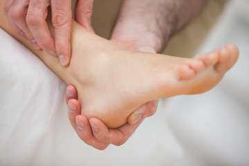Barefoot being massaged by a doctor