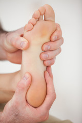 Physiotherapist working on a barefoot