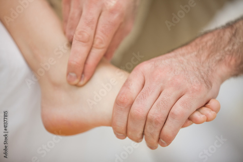 Physiotherapist massaging a barefoot