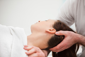 Doctor manipulating the neck of a woman