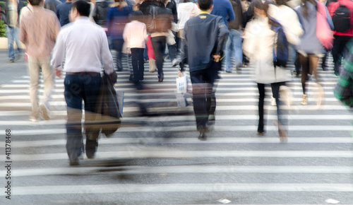 people crowd on zebra crossing street
