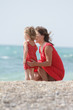 happy mother and daughter on sea background