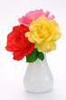 elegant red pink yellow bouquet of roses in white vase on bright